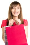Dreaming happy young woman with shopping bag. Dreaming happy young woman holding shopping bag isolated on white background Royalty Free Stock Photography