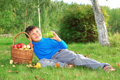 Dreaming kid posing outdoors Royalty Free Stock Images