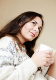 Dreaming lady with cup of tea Stock Image