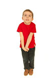 Dreaming little boy. Full length of dreaming happy little boy  isolate don white background Royalty Free Stock Image