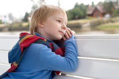 Dreaming little boy on a bench. The dreaming little boy on a bench Royalty Free Stock Photography