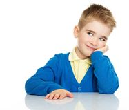 Dreaming little boy in blue cardigan. And yellow shirt Royalty Free Stock Photos