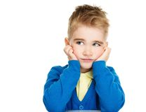 Dreaming little boy in blue cardigan. And yellow shirt Stock Images