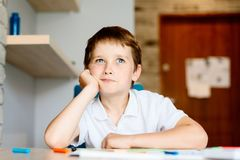 Dreaming little boy child. In white polo shirt Stock Photos