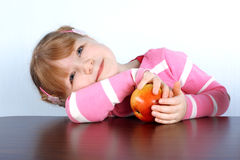 Dreaming little girl with apple Royalty Free Stock Photos