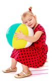 Dreaming little girl blonde with big inflatable Stock Photos