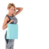 Dreaming lovely woman with shopping bag Stock Images