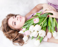 Dreaming lovely young girl with bouquet flowers Royalty Free Stock Images