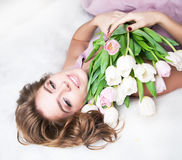 Dreaming lovely young girl with bunch of flowers royalty free stock image