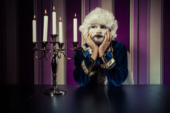 Dreaming, man dressed in rococo style, concept of wealth and pov Stock Photography