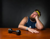Dreaming man and a dumbbell Stock Photos