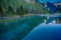 Dreaming mountain landscape scene. Idyllic landscape scene, blue and clear lake reflection on the water .From the italian alps mountains stock photos