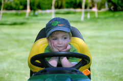 Dreaming Mower Kid stock photography