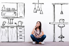 Dreaming about new kitchen. Royalty Free Stock Photos