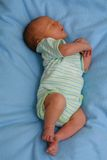 Dreaming newborn baby Stock Photos