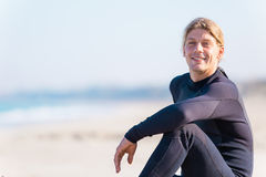 Dreaming of the next big wave. A young surfer with his board on the beach Stock Images