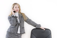 Dreaming on the phone. A woman leaning on a chair and talking on a mobile Royalty Free Stock Photography