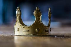 Dreaming about power may end with creating a fake, plastic gold crown royalty free stock photos