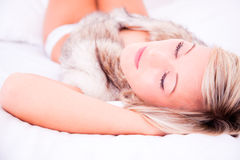 Dreaming pretty woman. Sweet blonde bed lying female girl Stock Images