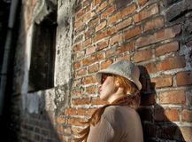 Dreaming pretty woman with white hat Royalty Free Stock Photo