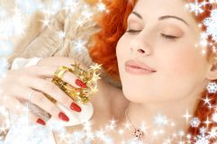 Dreaming redhead with white christmas bells  Royalty Free Stock Photography