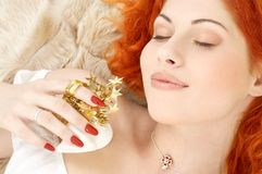 Dreaming redhead with white christmas bells Royalty Free Stock Photo