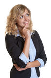 Dreaming secretary with blue blazer Stock Image