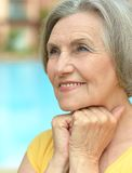 Dreaming senior woman at the resort Stock Photos