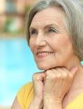 Dreaming senior woman at the resort Stock Photos