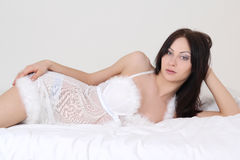 Dreaming sexy woman in white lingerie lying Royalty Free Stock Photo