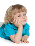 Dreaming smiling little boy. On the white background Stock Photography