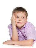 Dreaming smiling young boy Stock Photography