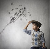 Dreaming of space. A young boy is dreaming of going into space stock photos