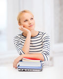 Dreaming student with laptop, books and notebooks Royalty Free Stock Photos