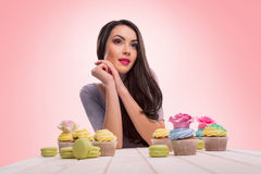 Dreaming sweet tooth with macarons Stock Photography