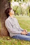 Dreaming teenager in park Royalty Free Stock Photos