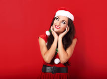 Dreaming thinking woman in santa claus christmas costume looking Royalty Free Stock Photo