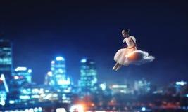 Dreaming to become ballerina. Mixed media. Ballerina kid girl in pink dress dancing. Mixed media stock photo