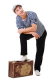 Dreaming traveller man with vintage suitcase Royalty Free Stock Photo