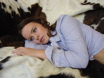 Dreaming woman. Pretty young women dreaming on a cowhide rug Stock Photo