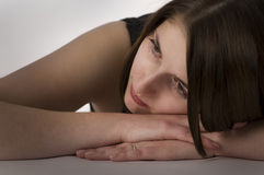 Dreaming woman. Pretty girl dreaming, laying her head on her hand Royalty Free Stock Photo