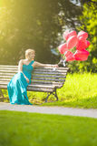 Dreaming Woman With Air Balloons Outdoors Royalty Free Stock Images