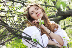 Dreaming woman in blooming garden Stock Photography