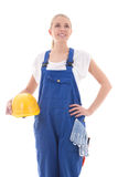 Dreaming woman in blue builder uniform holding yellow helmet iso Stock Photo