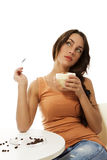 Dreaming woman with cappuccino coffee sitting at a Stock Images