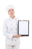 Dreaming woman in chef uniform holding clipboard with copy space Royalty Free Stock Photos
