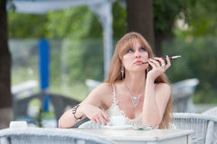The dreaming woman with coffee and a cigaret Royalty Free Stock Photo