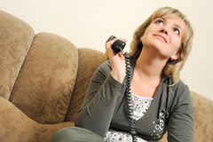 The dreaming woman after dialogue by phone Stock Photography
