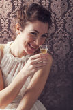 dreaming woman drinks a glass of excellent Scotch whisky Stock Photos