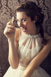 Dreaming woman drinks a glass of excellent Scotch whisky Stock Images